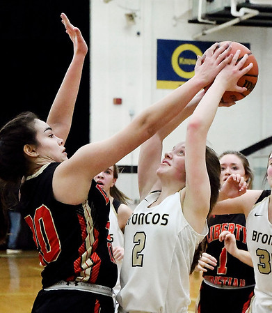 Liberty Christian's Elena Tufts gets her hand on the ball as Daleville's Emi Isom attempts a shot. Tufts not only blocked the shot but took the ball away from Isom for a steal.
