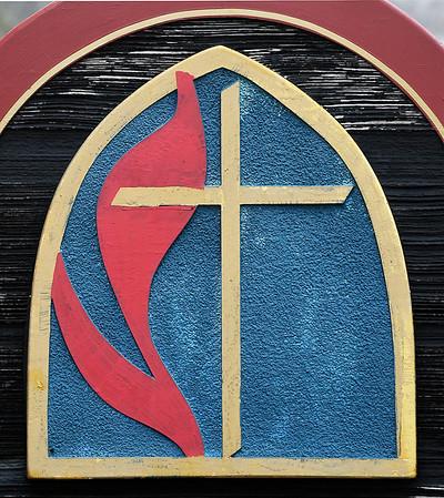 The United Methodist Church symbol that is on the sign of the Fortville United Methodist Church.