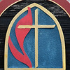 The United Methodist Church symbol that is on the sign of the Fortville United Methodist Church.