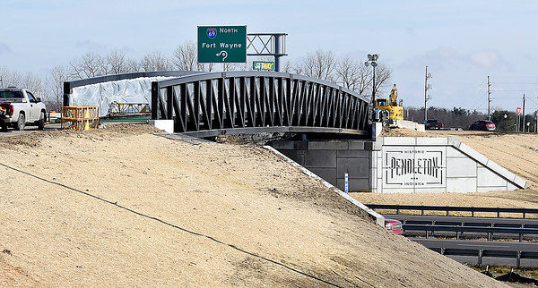 Workers continue to finish up the new bike/pedestrian bridge spanning I-69 along Ind. 38 Thursday in Pendleton. The pathway is a separate span to the highway that crosses over the interstate at the 219 mile marker.