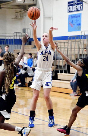 APA's Savannah Prewett pulls up for a jumper between the defense. Prewett needed 15 points to score 1,000 for her career.