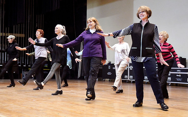 The senior tap group, Time Stepper, goes through their routine on stage at the Paramount Theatre Wednesday evening in preparation for Saturday's Dancing Like The Stars competition. This is the 12th annual benefit and the second year for team dancers to compete.
