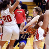 APA's Tommya Davis gets sandwiched between Elena Tufts and Cydnie Layton of Liberty Christian as she tries to cut through the lane.