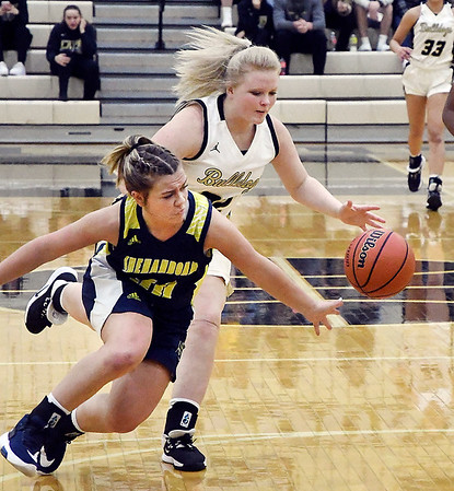 Shenandoah's Hannah Zody dives after the ball as Lapel's Lily Daniels looses control of the ball while bringing it up the court.