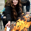 "COMPASS student Madi Juday puts her letter into the fire as she says ""I release you""  as part of the burning ceremony held at the school Monday. Students wrote private letters describing their feelings and emotions."