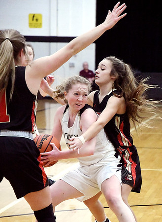 Daleville's Ashlyn Craig gets boxed in by Liberty Christian's Maddy Harmon and Irelynd Evans.