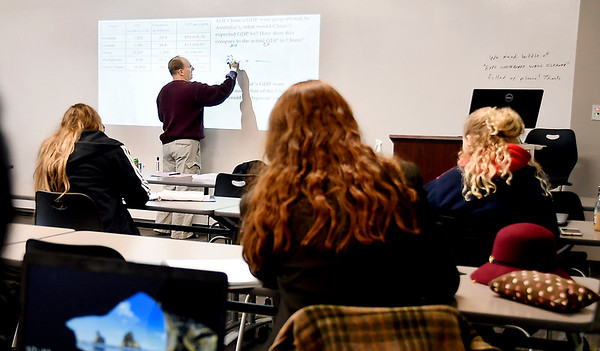 Ivy Tech assistant professor Duane Wolfe goes through a problem in his Quantitative Reasoning class Monday at the 60th Street campus.
