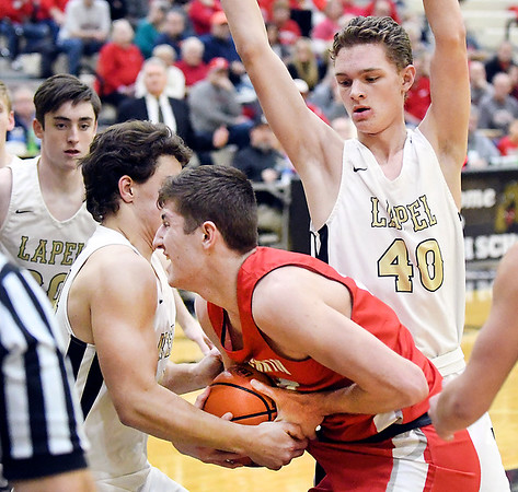Frankton's Zack Davenport gets cutoff on the baseline as Lapel's Cole Alexander and Corbin Renihan collapse on him and go for the ball.