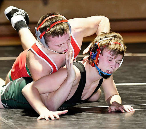 Anderson's Andrew Dietz tries to get a hold on Pendleton's Blake Nicholson in their 120 pound match. Dietz won the match 4-2.
