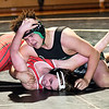 Pendleton's Justin Stephens gets Anderson's Clayton Stephens on his back as he works to pin him in their 220 pound match.
