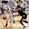 APA's Savannah Prewett drives to the basket as Nyla Sharp of Howe tries to cut her off.