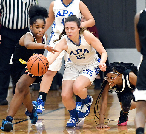APA's Chelsea Klepfer goes after the loose ball as Howe's Keonte Jiggetts and Naomi Burch scramble for the ball too.