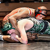 Anderson's KJ Williams works on Pendleton's Gavin Metschke in their 132 pound match. Williams pinned Metschke for his 100th victory.