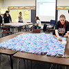 COMPASS students making blankets as part of the school's third annual Day of Gratitude.