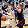 Lapel's Gracie Lyons drives into the lane working to get a step on Camryn Wise of Wapahani.