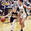Shenandoah's Kathryn Perry tries to get a step on Delany Peoples of Lapel as she drives into the front court.
