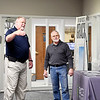 Grace Baptist Church assistant pastor Doug Stein and maintenance supervisor Melvin Wittkamper discuss security issues dealing with the entrance near the church office and leading to the sanctuary.