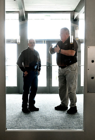 Grace Baptist Church assistant pastor Doug Stein, right, and maintenance supervisor Melvin Wittkamper discuss security issues in the main entryway that leads into the sanctuary of the church.