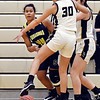 Shenandoah's Erikka Hill gets her pass just under the outstretched  leg of Makynlee Taylor of Lapel as she gets boxed in along the baseline.