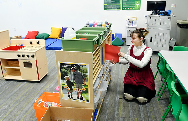Danielle McLaughlin, daycare worker, checks the inventory of items in the new daycare area at Ivy Tech's 60th Street campus Monday. Ivy Tech has partnered with the YMCA to offer free onsite daycare for their students.