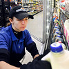 Harvest Market employee Taylor Sarvis stocks the dairy section with fresh milk at their 8th & Scatterfield store this week. According to the U.S. Department of Agriculture Americans have been drinking considerably less milk for decades.