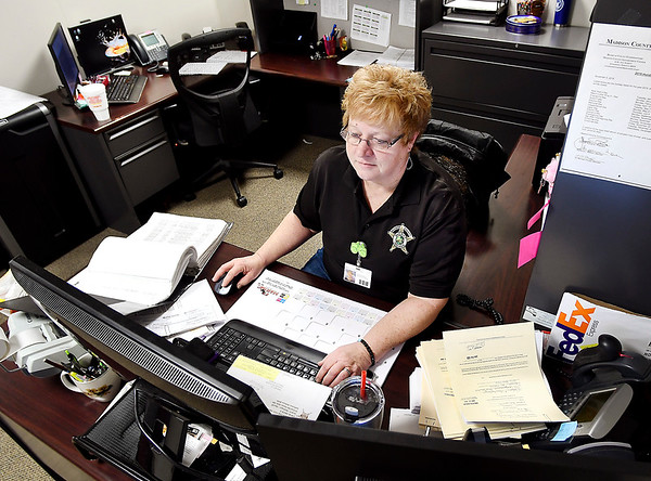 Deena Watkins, administrator of the Sheriff's Civil Office, coordinates the Sheriff's Sale of properties.