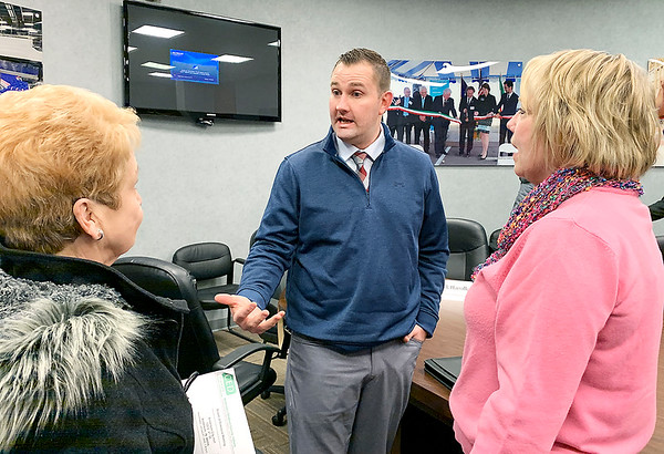 Clayton Whitson, the new president and CEO of the Madison County Chamber of Commerce, talks with Georgeann Whitworth of the United Way of Madison County, left, and Marcy Fry, economic and community development director for the city of Elwood, following a recent meeting hosted by the Corporation for Economic Development at the Anderson City Building.