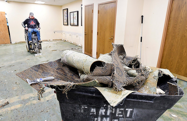 Workers from Indiana Flooring were removing all the old carpet from the former teen room Wednesday. The teen room will be relocated into a larger area when the renovations are complete.