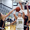 Liberty Christian's Maddy Harmon and Elena Tufts collapse on Daleville's Audrey Voss as she drives the lane for a shot.