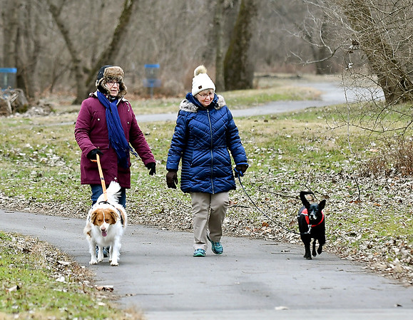 The cold temperatures didn't stop Jinny Kingery and Barbara Greenwalt from walking their dogs, Bella and Sammy, along the White River Trace - East trail through Edgewater Park. Temperatures are forecast to remain seasonal throughout this coming weekend.