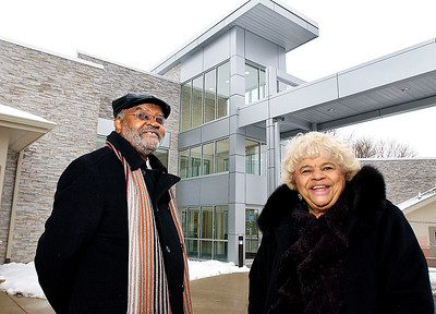 Anthony Malone and Rosetta Minnefield shown in front of the new wing of the Madison County Community Health Center in this THB file photo.