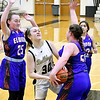 Lapel's Morgan Baker gets tangled up as she tries to split Elwood defenders Hannah McCleery and Alivia Boston.