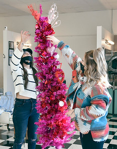 Staff members of Detour Salon & Style, Taylor Vanevenhoven and Tatum Shryock, decorate the shop for Valentine's Day. Most of the 22 employees there have told owner JB Shelton that they plan on being vaccinated when available to them.