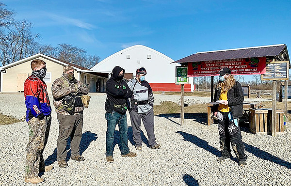 "Referee Ben Lockhart, right, explains the ground rules to, from left, James Hill, Ron Hill, Brett Smotherman and Jayden Musso before the group takes the field Saturday for a boot camp exercise to train for ""Operation: Okinawa,"" a paintball scenario event at White River Paintball in Anderson."