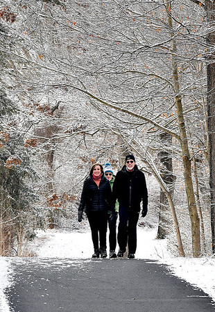 After the overnight snowfall these walkers found trail five at Mounds State Park to be a snow covered canopy as they made their way along the trail to the Great Mound Thursday morning.