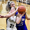 Lapel's Rosemary Likens eyes the basket as she gets pressure from behind from Elwood defenders.