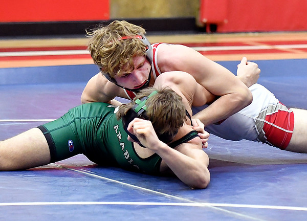 Frankton's Seth Lawson works to get Pendleton's Jared Brown over on his back as they wrestle the 138 pound class. Lawson defeated the two-time state finalist 8-2.