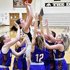 Lapel's Ashlynn Allman goes up for a shot while being surrounded by the entire Lady Panther team.