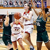 Frankton's Lauryn Bates goes up for a shot between Pendleton defenders.