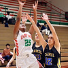Anderson's Makhile McWilliams pull up along the base line for a shot over Carmel defenders.