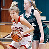 Frankton's Ava Gardner drives the lane as Pendleton's Abi Rosenkrans tries to knock the ball out from behind.