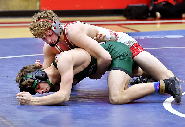 Frankton's Seth Lawson works to get control of Pendleton's Jared Brown as they wrestle the 138 pound class. Lawson defeated the two-time state finalist 8-2.