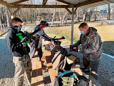 "James Hill, left, readies his paintball gun before taking part in a boot camp competition to prepare for ""Operation: Okinawa,"" an event scenario scheduled for late March at White River Paintball in Anderson."