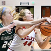 As Frankton's Chloee Thomas drives the lane Abi Rosenkrans, of Pendleton, gets a hand on the ball to try to block the shot.