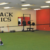 Justin Rummell uses a recoil band to help develop speed with Mitch Patishall, a PHHS graduate who plays baseball for University of Cincinnati and was recently drafted by the Chicago White Sox.