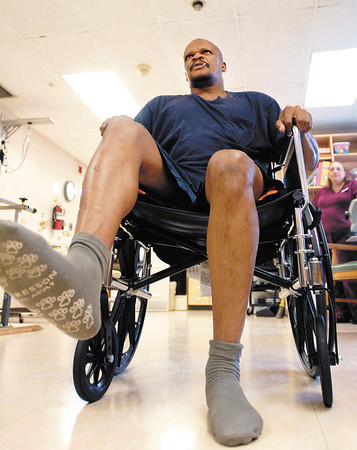 Shawn Hicks uses the new Omni VR virtual reality therapy program to do his physical therapy at Manor Care Health Services Monday.  Here Hicks uses a program called Picnic where he uses his legs to step on insects.  Hicks is recovering from having four strokes.
