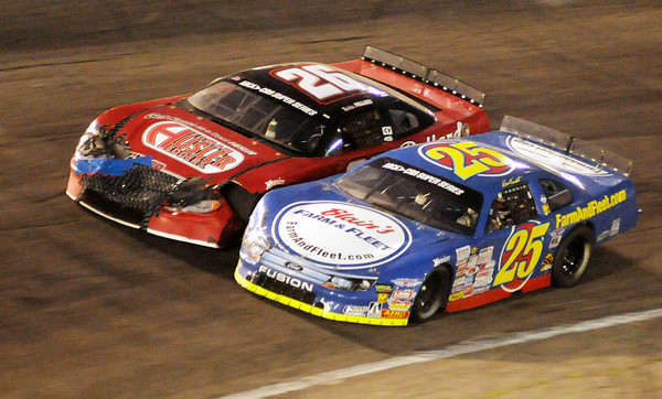 Ross Kenseth (25) passes Bubba Pollard (26) to take the lead on lap 250<br />  during the Redbud 300 at Anderson Speedway on Saturday.