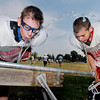Jacob Rowe, 13, from Seymour, and Rylund Marks, 11, from Kokomo, take a break for water Monday afternoon during the Bishop Dullaghan Football Camp they are attending at Anderson University.  The four day camp is for 6-8 graders and this is the 7th of 9 camps Bishop Dullaghan holds around the state during the summer.