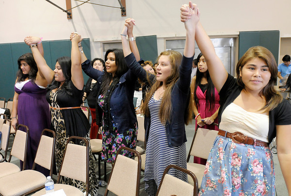 Participants in youth convention hosted by Anderson's Church of God of the Israelites at New Horizons United Methodist Church raise their hands in worship as the convention ended Wednesday.