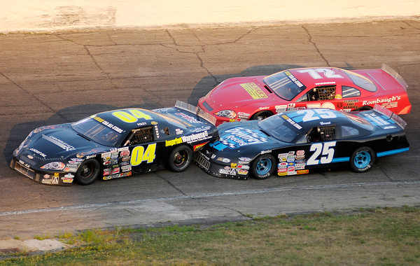 Brent Downey (25) bumps Jerrod Foley (04) as Thomas Woodin (72) falls of the pace during the JEGS/CRA All-Stars Tour 100 lap race at the Anderson Speedway on Friday.